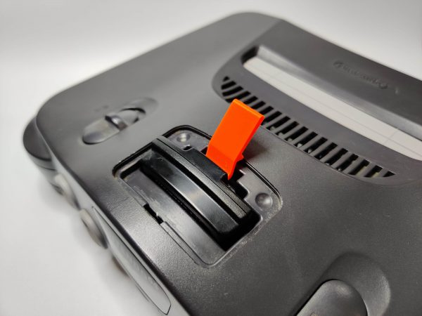 N64 Expansion Slot Ejector Tool Being Used